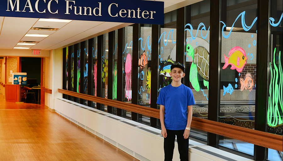 Boy standing in front of MAAC Fund Center